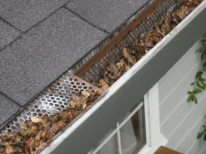 damaged roof gutter system with gutter gaurd