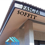 Labeled Fascia and Soffit on corner of eaves having corrugated metal roofing.